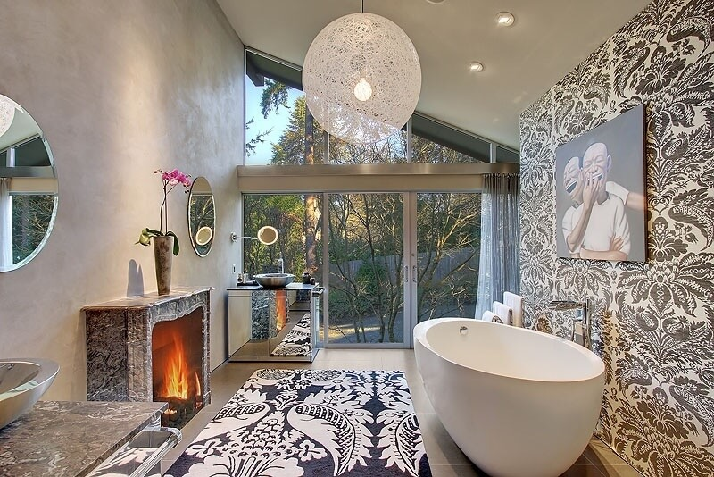 This High Ceiling Bathroom Splashes An Array Of Detailed Texture, With  Floral Print Wall And