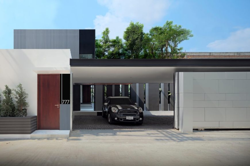 The street side of the structure houses this discreet garage, with open back design leading into the central home structure.
