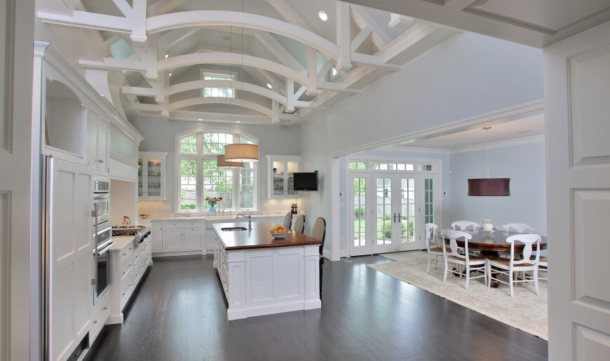 Custom White Kitchen Design With Soaring Ceiling By GTM Architects