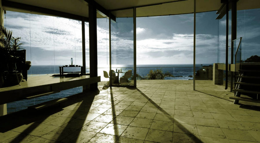 With the glass panels slid open, the living room can share open air with the ocean side exterior.