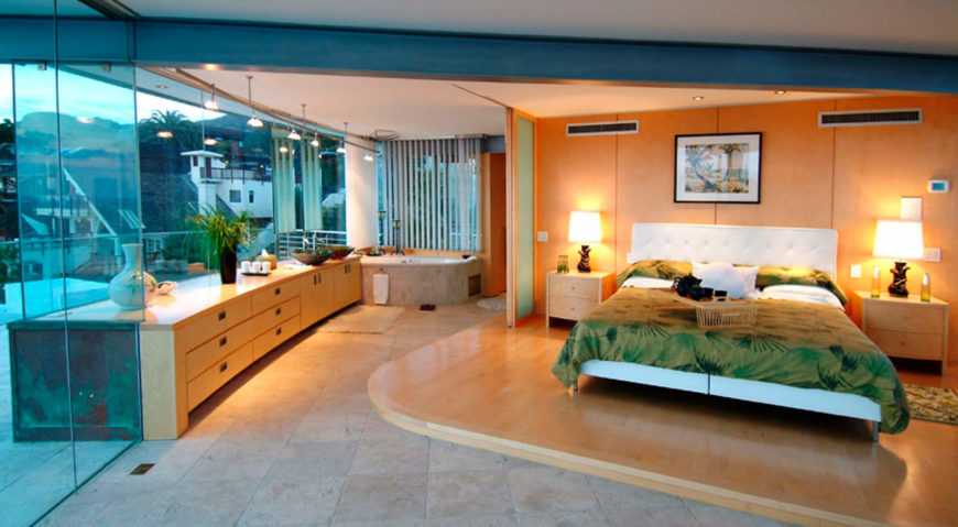 The master bedroom and bathroom en suite defines the bed with raised hardwood platform and retractible dividing wall.