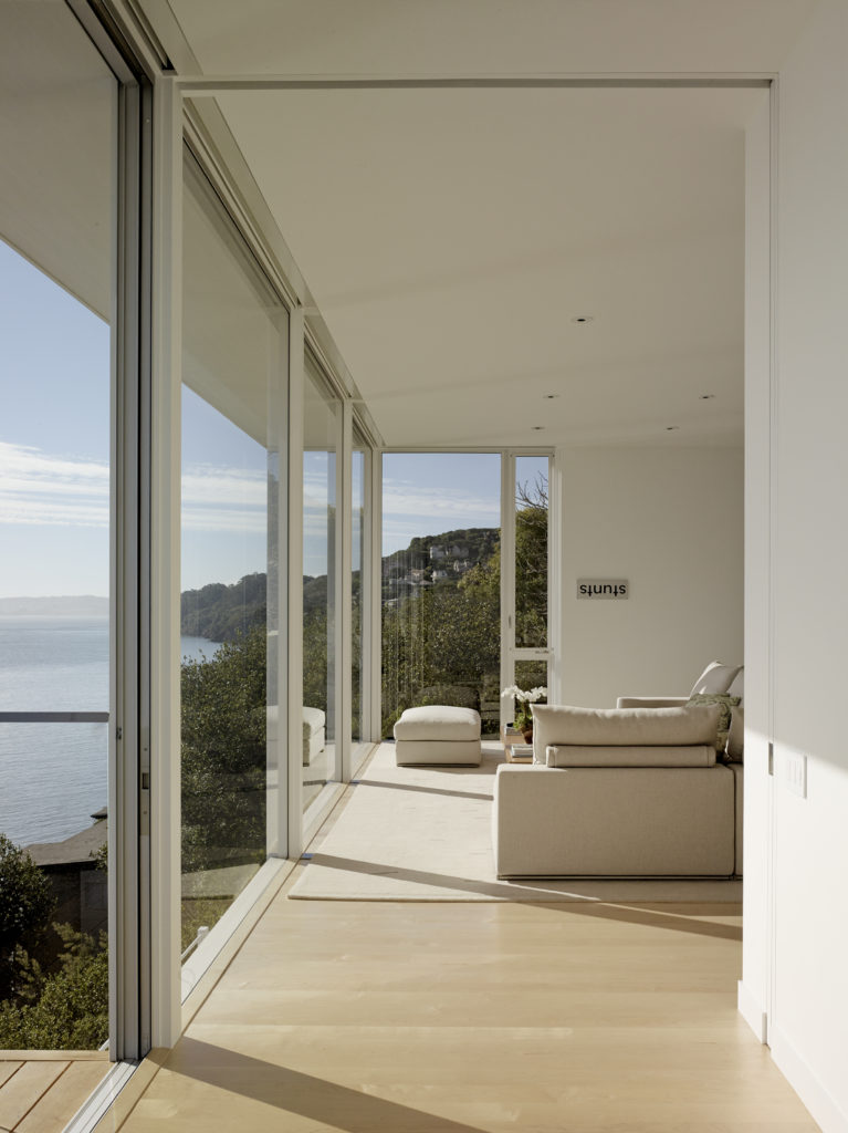 Another short hallway leads to the master bedroom, which has a balcony. Even from this angle, the home has a beautiful view of the water and of the surrounding hillside.