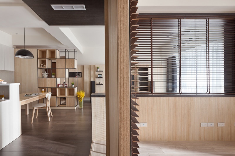 A cross-sectional view shows how the subtly varying wood grain and tones differentiate the rooms in this home.