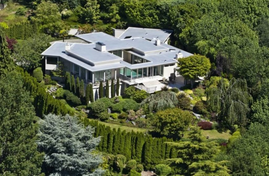 An aerial view truly showcases the glass-wrapped home's relationship with the natural surroundings. The entire structure also is seen to wrap around the open courtyard at center.