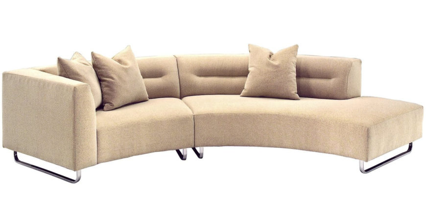 This sleek, cream toned sectional is a design variation on a prior model featured here, going for a more simplified look without the bulbous end-piece. Curved metal railing feet stand in contrast with the soft hues of the upholstery.