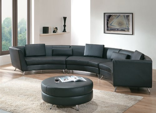 Here's another angular leather sectional, with upright back and arms hugging thick cushioned black toned seating. Angular chromed legs adorn even the matching circular ottoman, at center.