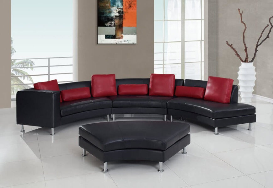 Here's a similarly configured contemporary leather sectional with curved backless segment, pictured at center in ottoman configuration. Low backs and stainless steel legs grant a sturdy, modern look, while red cushions add color and contrast.