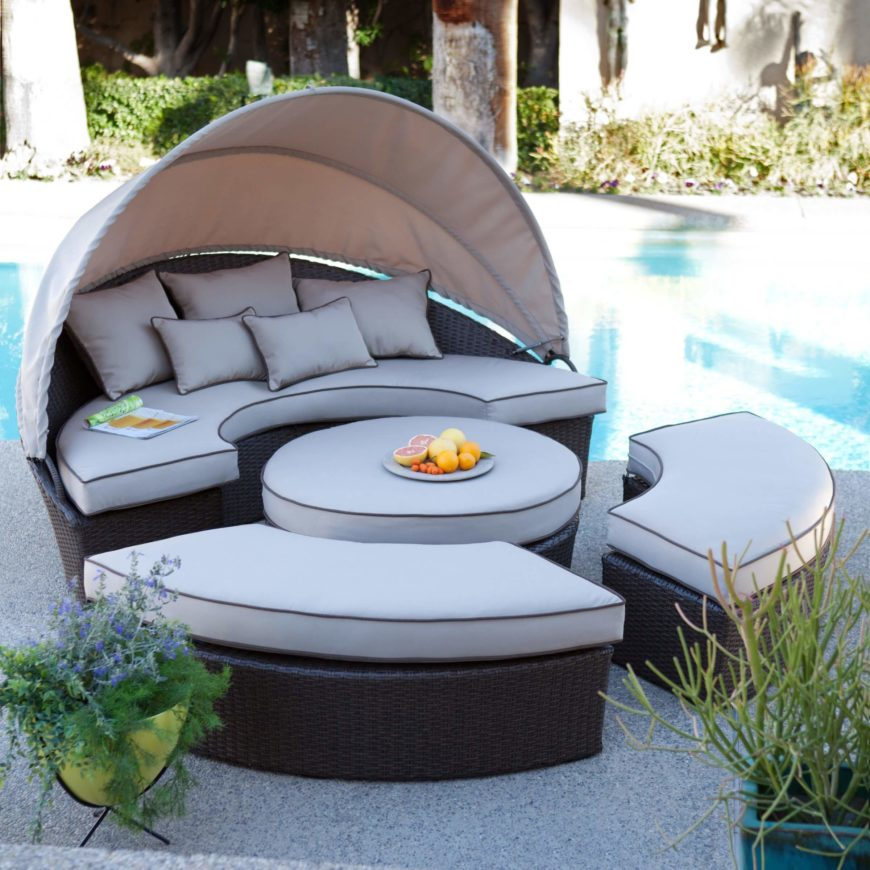 Here's another circular, wicker-based sectional for outdoors settings. With a large retractible umbrella component, it provides daybed functionality and privacy along with a variety of configurations.