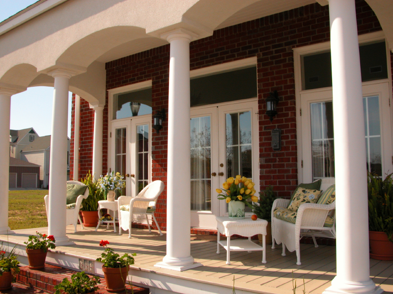 Elegant front porch with columns and no railing.