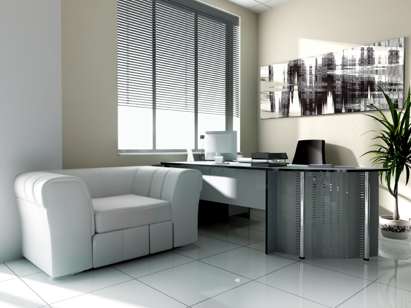 In this thoroughly modern home office, a contemporary industrial desk stands over large format white tile flooring, beneath a beige wall with greyscale art piece. An extra wide, white leather club chair adds comfort and softness.