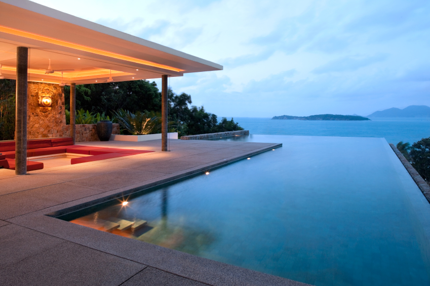 Gentil The Infinity Pool Has Stairs Leading Into It From One Corner Of The Patio.  The