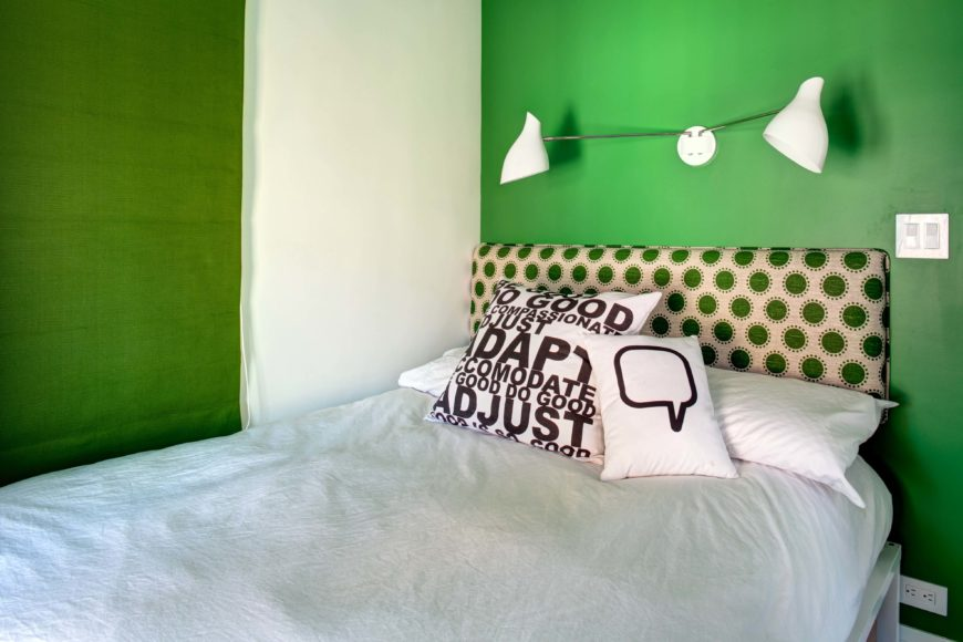 A second kids room features bold green walls over white bedding, while polka dots make another appearance in green on the headboard.