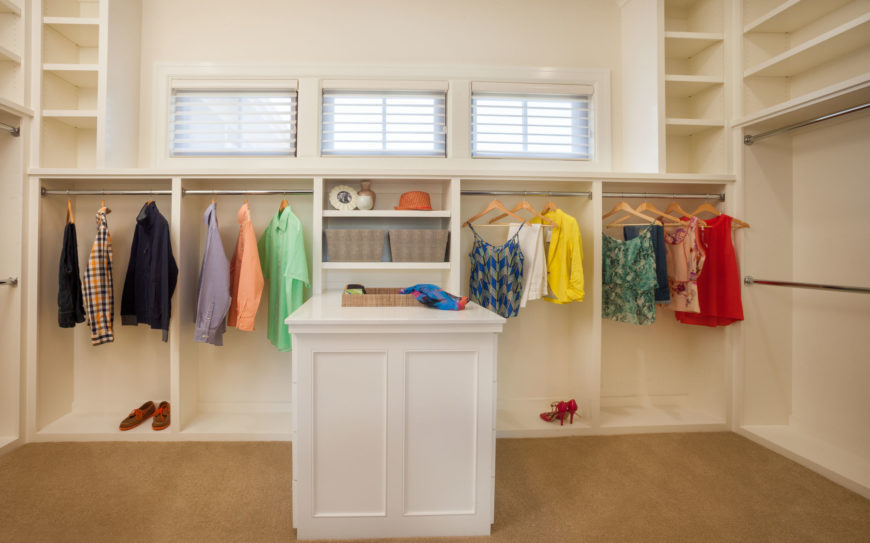 The master suite includes a spacious walk-in closet with tons of hanging space and a small center island.