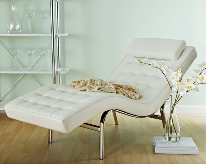 This chaise is a beautifully contemporary white leather design, with curved chrome frame. Subtly button tufted surface offers plush comfort.