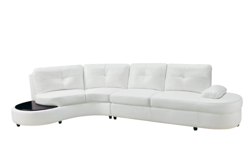This lengthy, white leather upholstered sectional in two pieces features another great example of the side-table piece, with dark stained wood tabletop at left.
