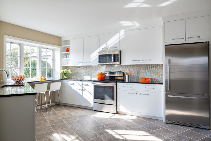 Beautiful triangle contemporary kitchen with high end appliances.