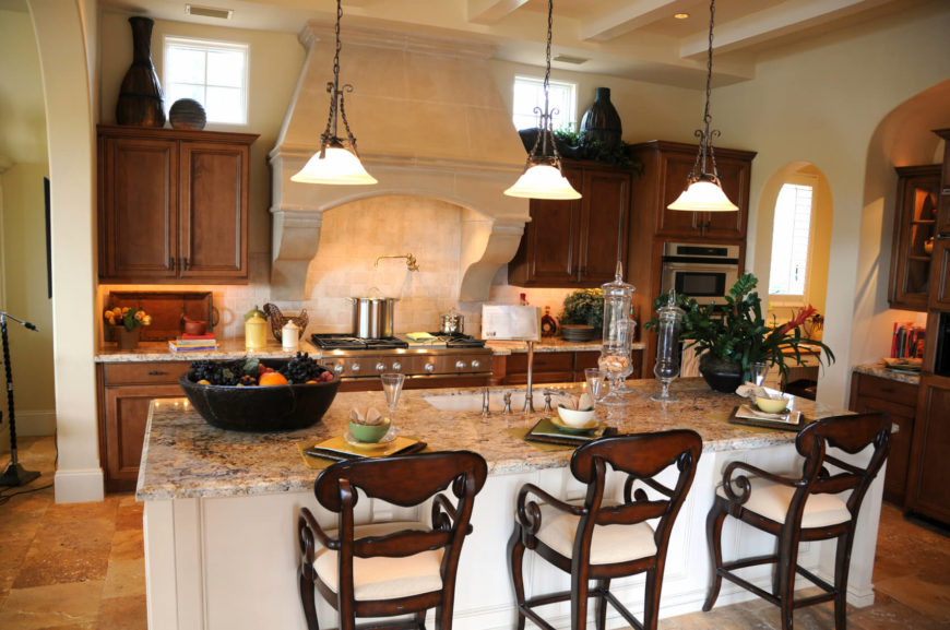 An Elegant Eat In Kitchen Of Modest Size, Featuring A Large Granite Island  With Part 85