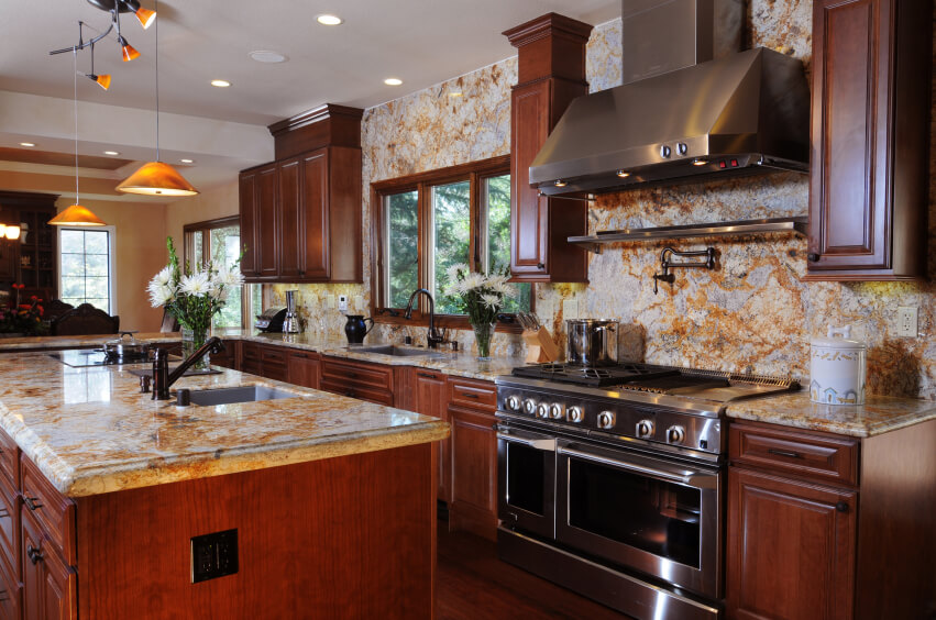 A Luxurious Rich Dark Wood Kitchen With An Enormous Amount Of Marble  Backsplash With Orange Veining