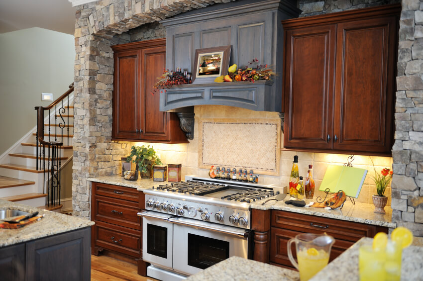 A Kitchen With A Small Preparation Area On The Island Across From The Stove  And Oven Part 46