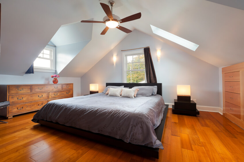 Sconces and cube lights along with multiple skylights and windows create a warm and welcoming attic & 60 Attic Bedroom Ideas (Many Designs with Skylights)
