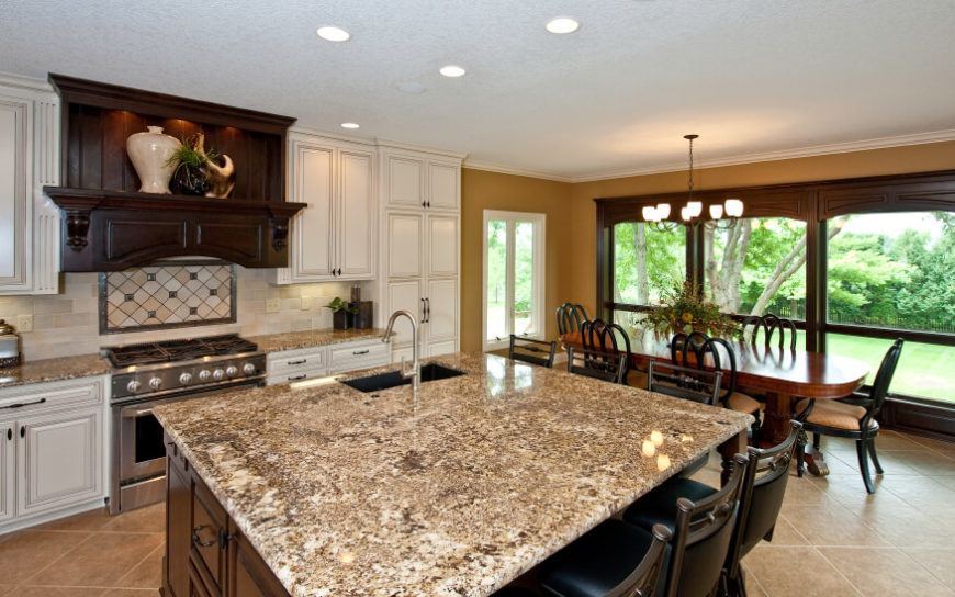 An Elegant Kitchen With Adjacent Dining Room The Busy Brown And Cream Granite Countertops