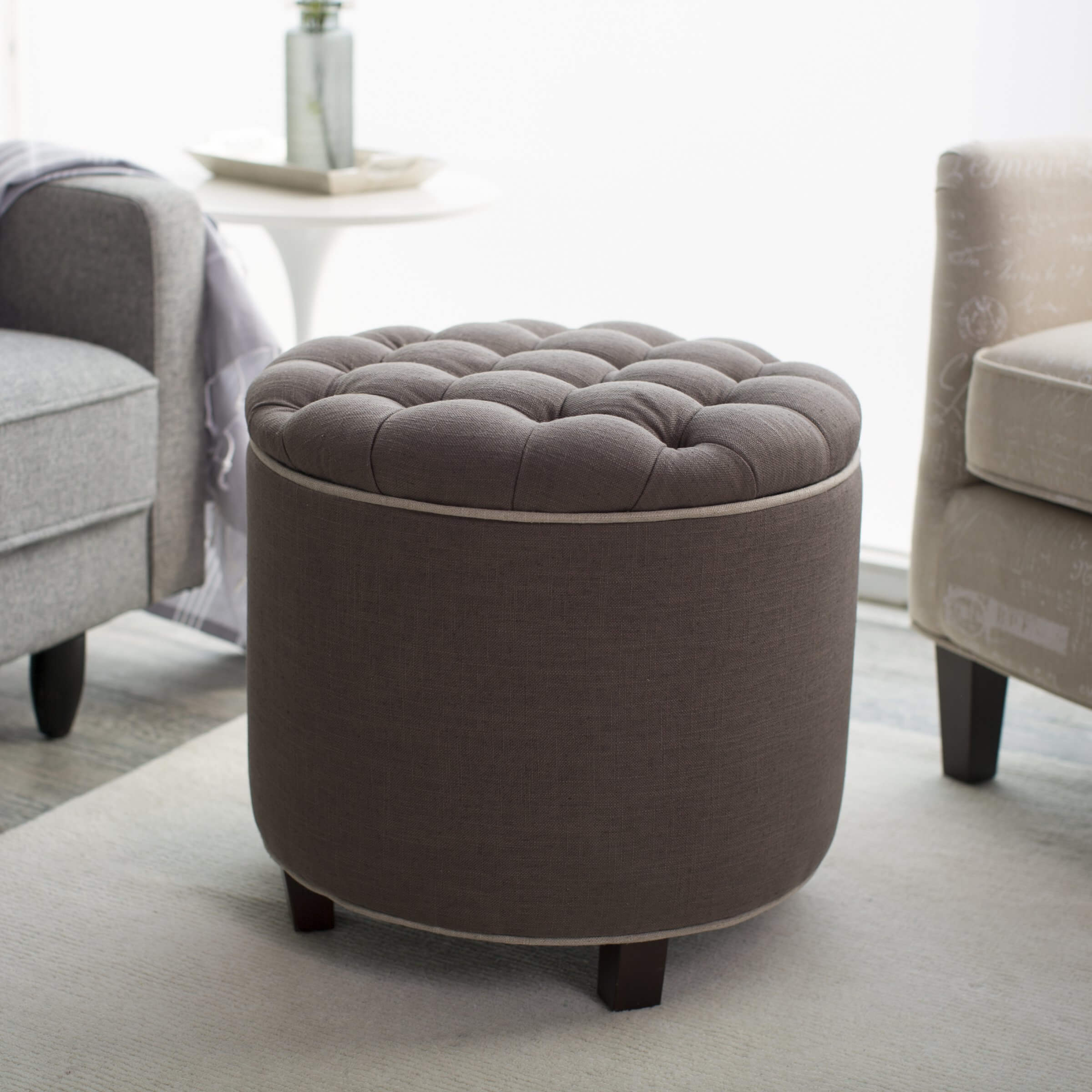 Hereu0027s A Taller, Round Ottoman With Light Chocolate Tufted Upholstery,  Standing Mildly Apart From
