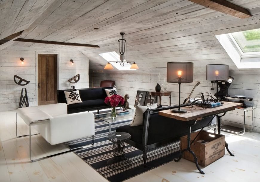 An attic used as a family room. This white and black space has both modern elements and rustic accents for a an interesting, unique room.
