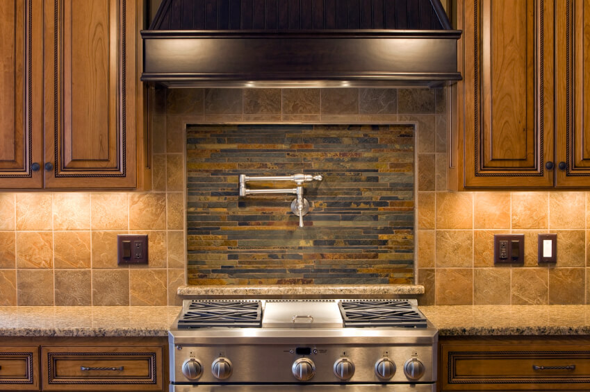 Captivating A Beautiful Kitchen In Shades Of Brown With A Stone Backsplash And An Inset  Center Focal