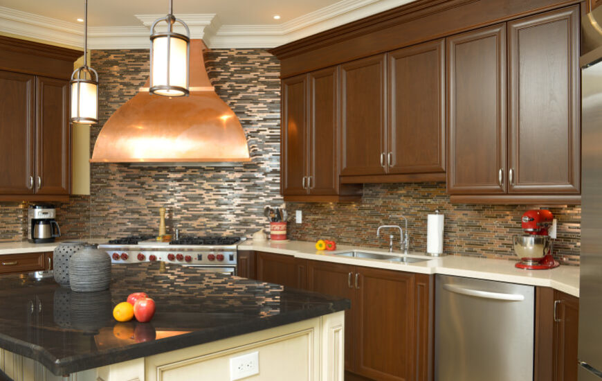 A Kitchen With An Interesting Glass Tile Backsplash That Looks Different  Depending On The Angle Of