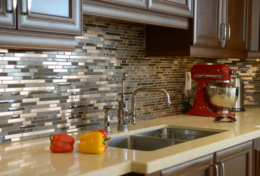 In The Right Light, The Backsplash Appears To Be Made Out Of Copper, When