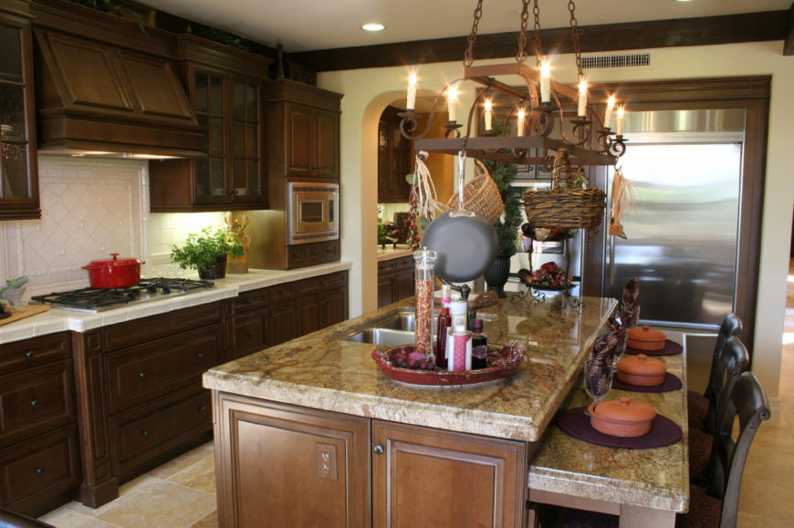 A Country Kitchen With A Two Tiered Kitchen Island With Seating For Three.  The Part 79