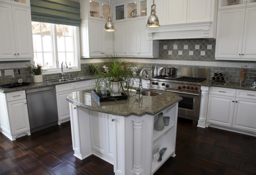 Delightful A White Kitchen With Olive Green Tile Backsplash And An Ornate Dark Wood  Floor