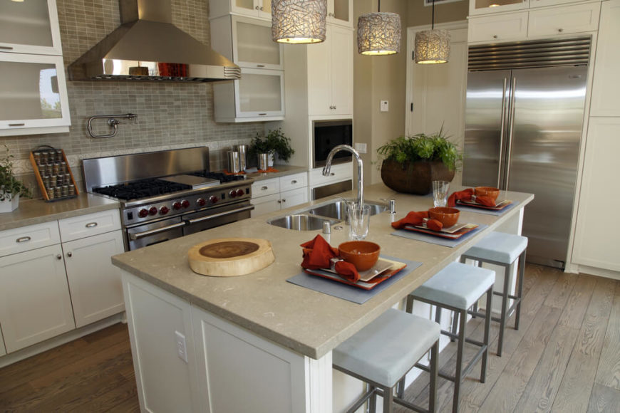 A Contemporary Kitchen In Gray And Beige With Bold Accents Of Orange. The  Wide Stove Part 26