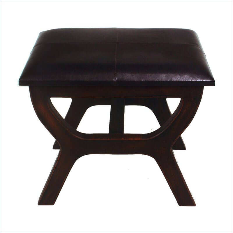 Here's a more table-like ottoman, with lengthy A-frame legs in dark stained wood. Dark leather cushioning on top is discreet and slim.