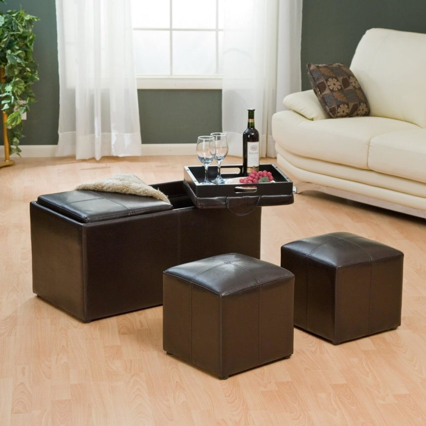 This is a truly utilitarian bench ottoman, with dual removable seat cushions and storage space for a pair of matching cube ottomans. The lids flip to reveal portable tray tables, making for a versatile piece of furniture.