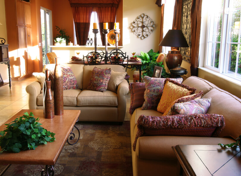 A Living Room With Southwestern Flair And Fantastic Patterned Throw Pillows  On The Beige Sofa And