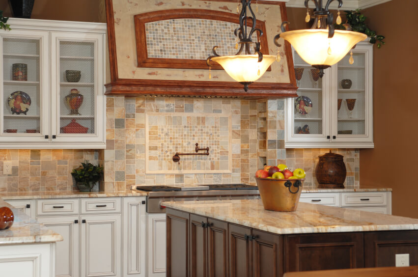 A Multi Colored Stone Backsplash With Tiles In Varying Shapes. A Section In  The