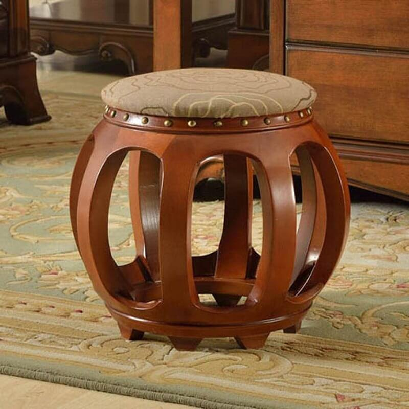 Here's a truly unique ottoman, with a spherical open wood frame beneath a slim cushion top. Nail head trim at the top adds a bit of textural detail.