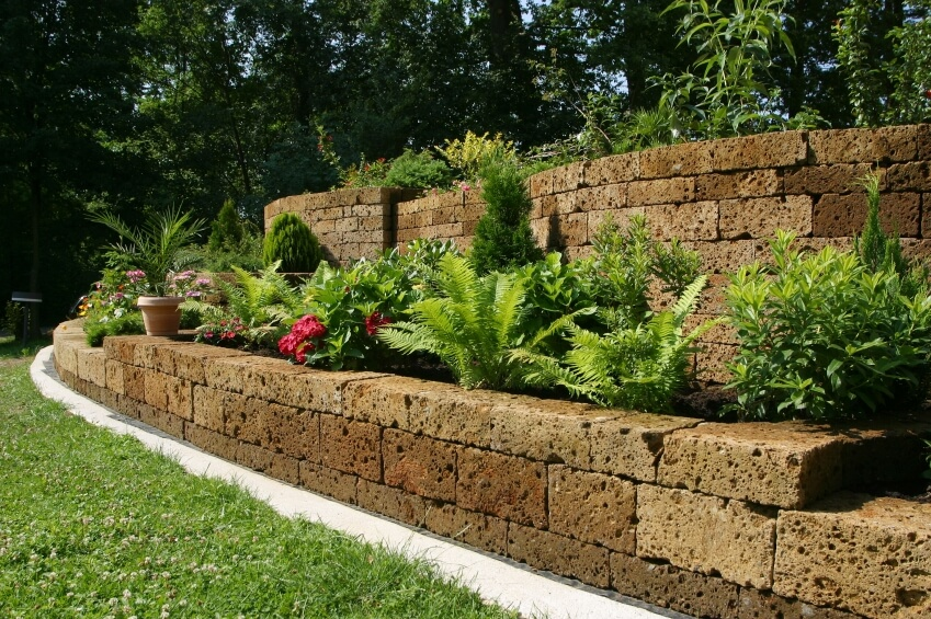 The stones used to create these terraces and retaining walls are speckled with small holes that give them the appearance of a kitchen sponge.