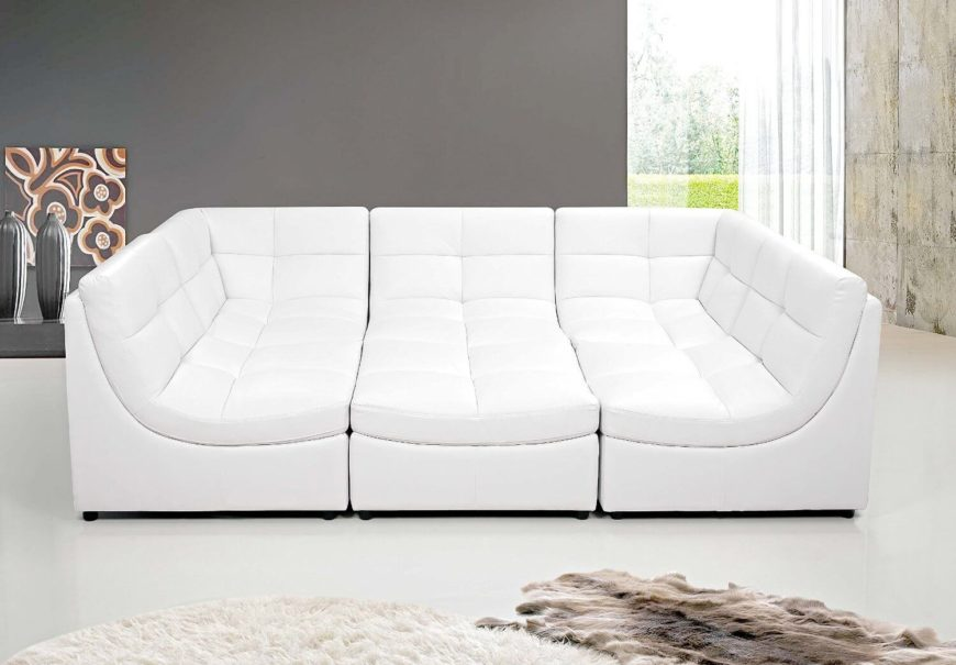 The white faux leather is soft, comfortable, and will last. It can be modified into a more traditional L-shaped sectional, or any other shape you desire. Shown below is an orientation perfect for a sleepover.