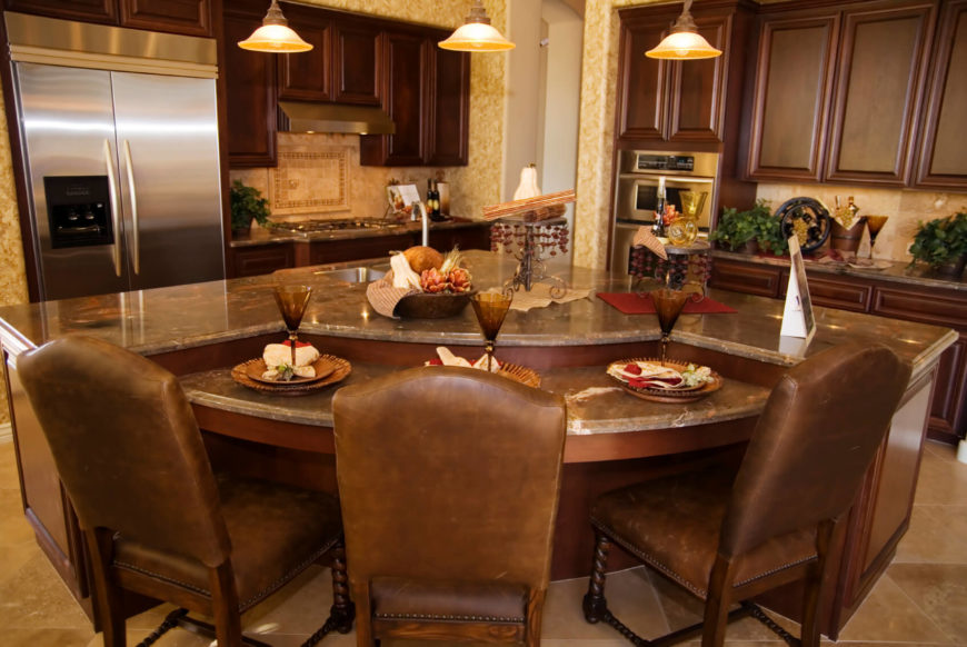 A Luxurious And Modestly Sized Kitchen With A Lower Level Of The Island For  Dining Part 25