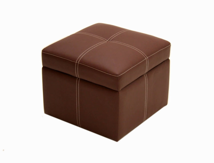 This small, footless cube ottoman is wrapped in lighter brown leather with a double stitch design adding contrast and detail. Cushioned lid lifts to reveal storage.
