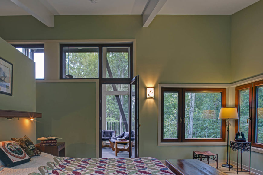On the second floor, the master bedroom has a lovely quilt and more of the same windows as on the main level.