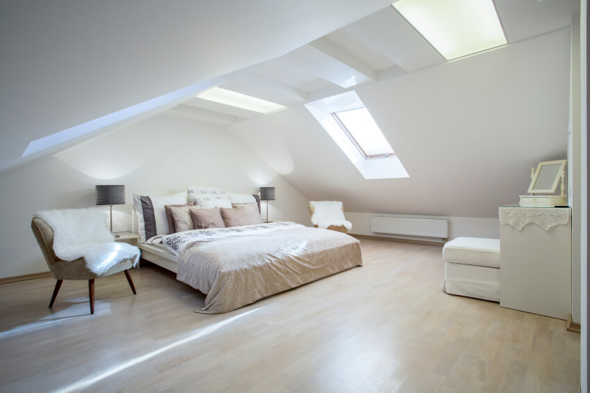 Master bedroom in large attic with skylights