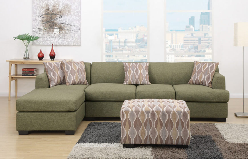 An elegant green linen modular sofa with throw pillows and a matching ottoman. The design is reversible, allowing you to position the chaise on the left or right.