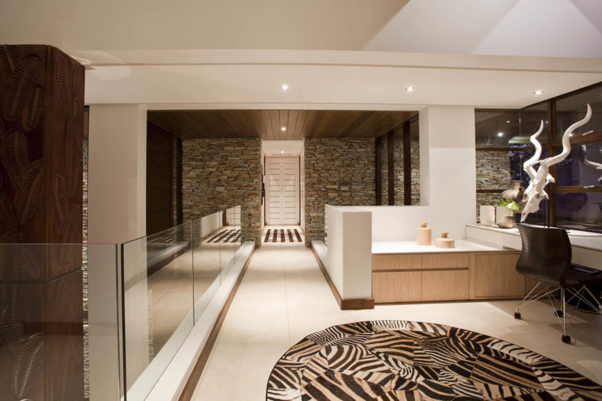 The office area sits halfway along a catwalk hall leading toward the private bedroom area.
