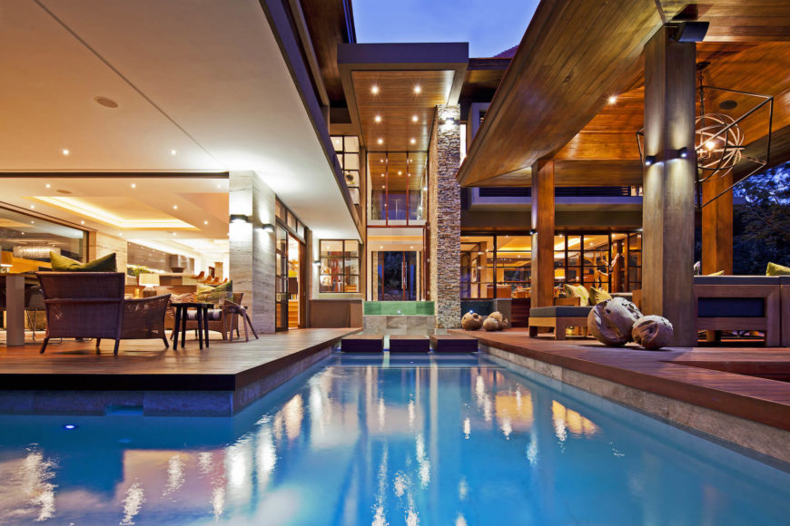 Seen from the opposite side, the large central water feature is this L-shaped pool running throughout the patio space.