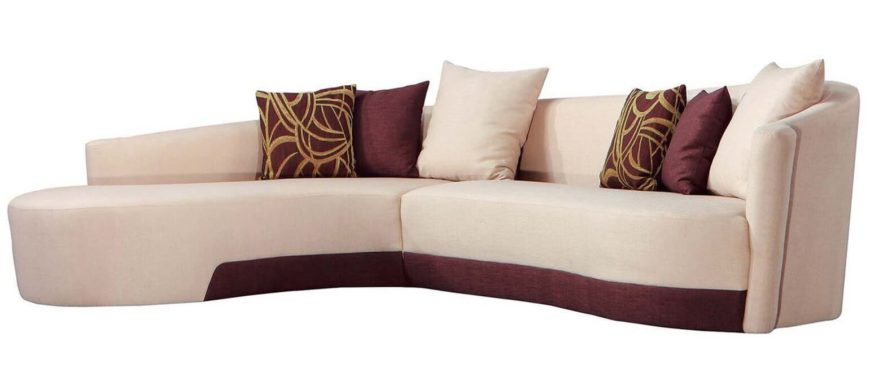 An elegant beige and plum sectional with matching throw pillows in a beautiful left-curving design perfect for an old Hollywood style home.