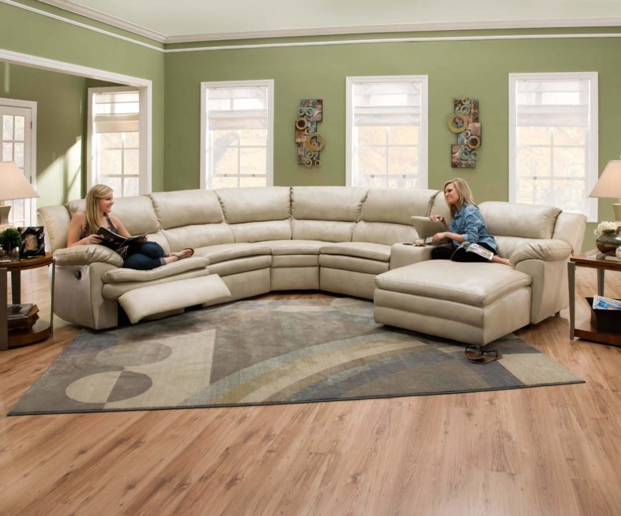 Soft wheat toned leather wraps this thick cushioned sectional a lengthy piece incorporating both a . : sofas with chaise on one end - Sectionals, Sofas & Couches