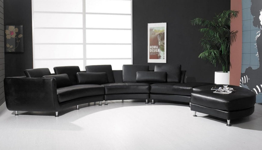 This black leather sectional creates a wide sweep of seating, with bespoke contrast between black Italian leather and chrome legs. Strategically placed back pillows enhance comfort.